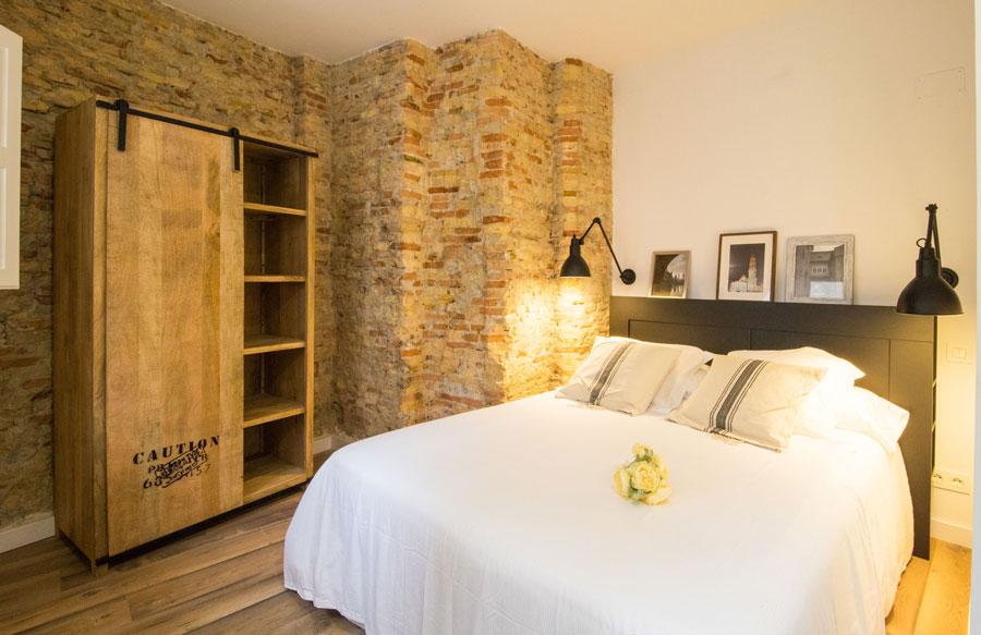 Dormitorio en Madrid con decoración raw style
